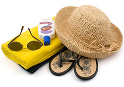 Straw hat, sunscreen and sunglasses
