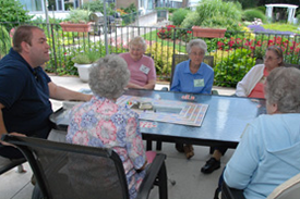 Seniors playing game outside